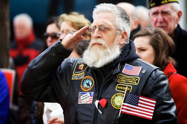 Steve Betters, a 20-year veteran of the U.S. Army, salutes during the singing if the national anthem Monday during Veterans Day observances in Portland.