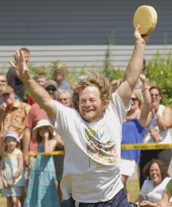 Dan Greeley of Belfast celebrates after winning in his age group at the U.S. National Cheese Roll Championship, part of the Maine Celtic Celebration in Belfast on Saturday.
