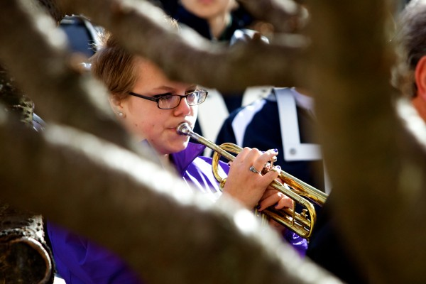 Deering High School junior Katelyn Irish plays taps at the close of Veterans Day observances in Portland Monday.
