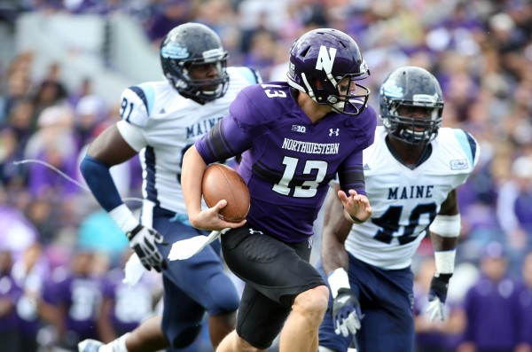 Northwestern quarterback Trevor Siemian (13) is pursued by Maine's Jonathan Lewis (91) and linebacker Christophe Mulumba (40) during their game on Sept. 21 in Evanston, Ill.