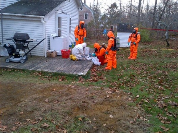 Agents and members of the Maine Drug Enforcement Agency clandestine lab team process the scene Friday at a home on South Shore Drive in Owls Head where they believe methamphetamines were being manufactured.