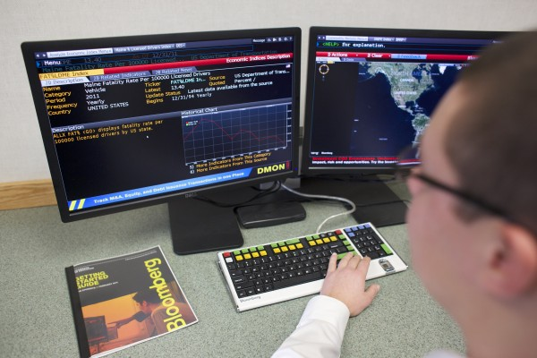 Adam Bates shows the Bloomberg terminal in a computer lab at University of Maine in Orono. Undergraduate enrollment at the Maine Business School at UMaine is at an all-time high of 947 students, an increase of nearly 21 percent from a year ago.