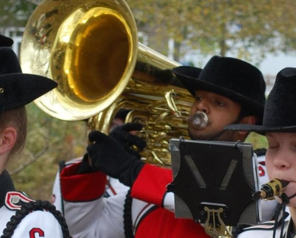Calvin Stanly, on sousaphone, plays &quotThe Star Spangled Banner&quot on Monday, Nov. 11, during Veterans Day ceremonies at Mill Creek Park in South Portland. Stanly and classmate Elizabeth Small will march on Thanksgiving in New York City as part of the Macy's Great American Marching Band.