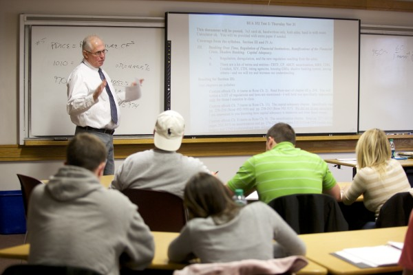 Richard Borgman, professor of finance at UMaine teaches a class Tuesday morning in Orono. Undergraduate enrollment at the Maine Business School at UMaine is at an all-time high of 947 students, an increase of nearly 21 percent from a year ago.