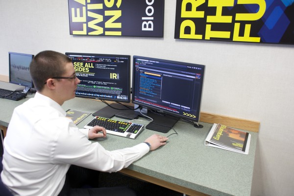 Adam Bates shows the Bloomberg terminal in a computer lab at University of Maine Orono. Undergraduate enrollment at the Maine Business School at UMaine is at an all-time high of 947 students, an increase of nearly 21 percent from a year ago.