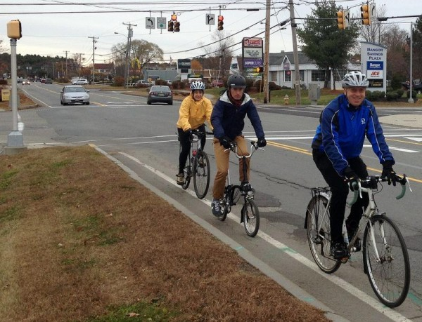 Debra Coyman, left, Mike Lydon and Pat Connolly ride on U.S. Route 1 on Tuesday, Nov. 12, as part of a &quothandlebar tour&quot of Falmouth to identify areas where bicycling and pedestrian paths could be improved. Lydon, a principal for urban planning group The Street Plans Collaborative, is evaluating five area towns and will present a master improvement plan for the area in December.