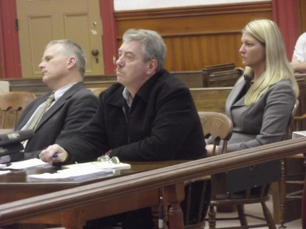Clifford Thornton Jr. (center) is flanked by his legal defense team, including Bangor attorney Stephen Smith (left), as his trial in Washington County Superior Court began in Machias Monday morning. Thornton is accused of committing eight sex crimes with three young girls in his Calais home.