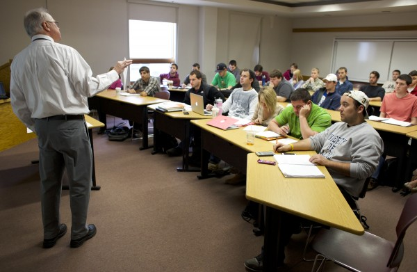 Richard Borgman, professor of finance at UMaine, teaches a class Tuesday morning in Orono. Undergraduate enrollment at the Maine Business School at UMaine is at an all-time high of 947 students, an increase of nearly 21 percent from a year ago.