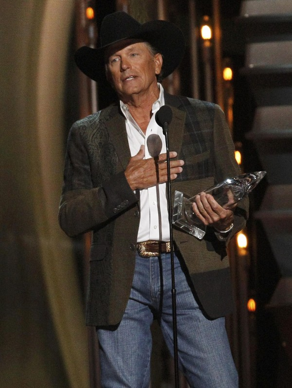 George Strait accepts the award for entertainer of the year at the 47th Country Music Association Awards in Nashville, Tennessee Nov. 6, 2013.