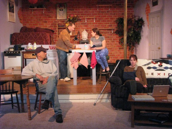 A scene from Ten Bucks Theatre's &quotTime Stands Still,&quot featuring Ron Lisnet (from left), Doug Meswarb, Moira Beale and Kathryn Ravenscraft.