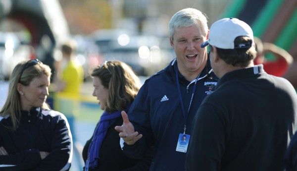 Outgoing University of Maine athletic director Steve Abbott socializes along the sidelines during the Black Bears football game against Stony Brook on Nov. 2.
