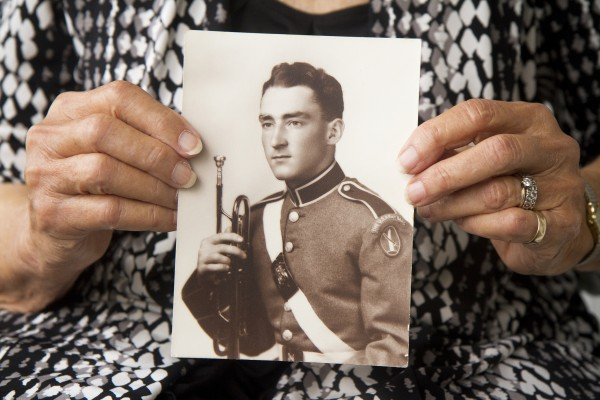 Army Sgt. Keith Clark'€™s widow, Marjorie Clark, holds a photo of the bugler.