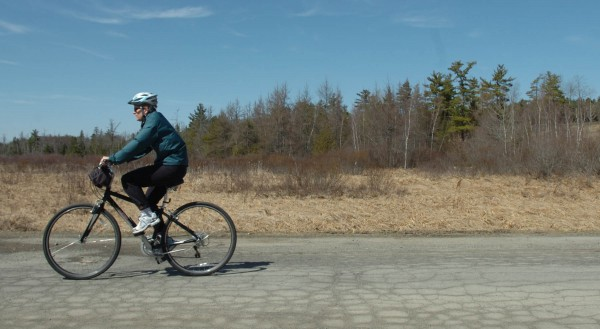 A cyclist pedals down University Farm Road on Tuesday, April 12, 2011.