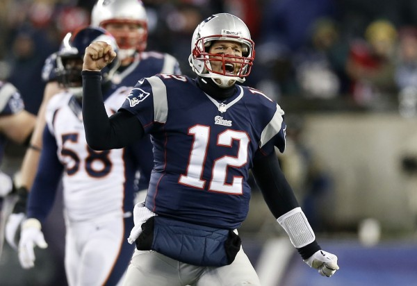 New England Patriots quarterback Tom Brady (12) reacts after a completed pass against the Denver Broncos during overtime at Gillette Stadium in Foxborough, Mass., Sunday night.