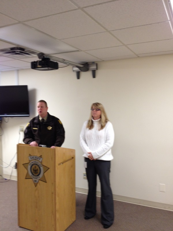 Chief Deputy Troy Morton of the Penobscot County Sheriff's Office and Penobscot County Emergency Management Agency director Michelle Tanguay prepare to address reporters regarding a scam in Bangor on Wednesday.