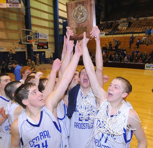 The Central Aroostook team celebrates their victory in the Eastern Maine Class D championship game over Hodgdon. Central Aroostook won the game 58-55 in overtime.