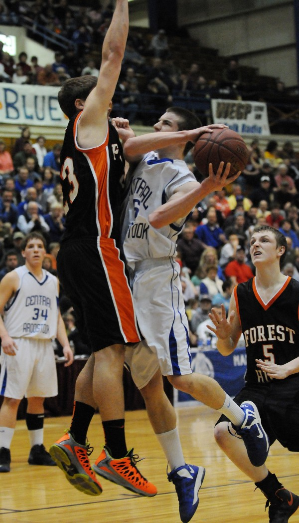 Central Aroostook's Chandler Brewer takes a shot while being closely guarded by Forest Hill's Evan Worcester during class D state championship action in March at the Bangor Auditorium. Also in on the action is Forest Hill's Ryan Petrin.