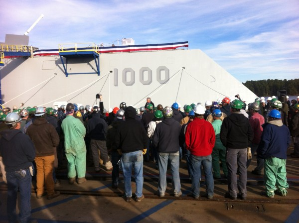 Shipbuilders and the crew of the DDG 1000 at Bath Iron Works listen to Secretary of the Navy Chuck Hagel speak on Thursday.