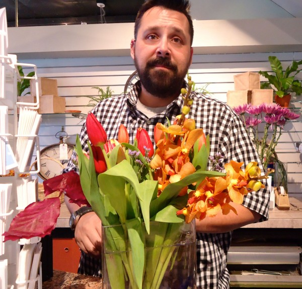 Jason Parent, manager of Harmon's & Barton's on Congress Street, donated flowers to Milo Lewis this week.