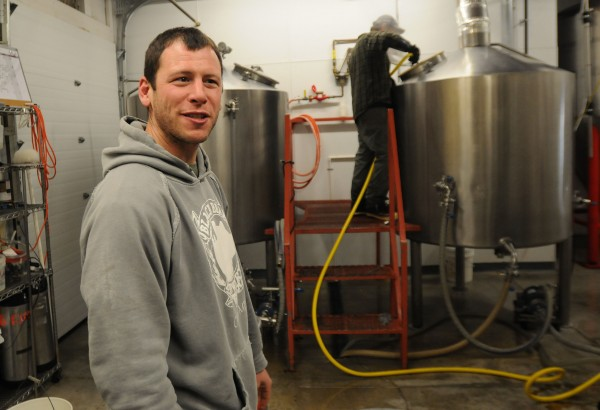 Tim Gallon shows off his beer making production area at Black Bear Brewery in Orono on Wednesday. Gallon has expanded his taproom to include a larger area where patrons can sip beer and listen to live music.