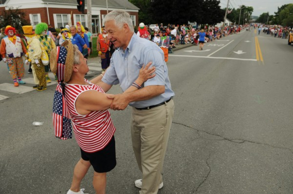 Mike Michaud gets a hug from a supporter before the Bangor/Brewer Fourth of July parade in 2012.
