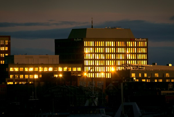 The Key Bank building, right, and its neighbors reflect the sky at sunrise, Tuesday, Nov. 19, 2013, in Portland, Maine.