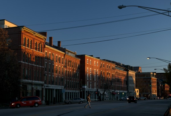 A man crosses Commercial Street at sunrise, Wednesday, Nov. 20, 2013, in Portland, Maine.