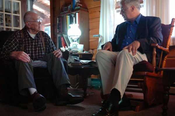 Rep. Mike Michaud (right) visits with Walter Henderson, 87, at his Hampden home to talk about Henderson's hospice care and veterans' services in 2009.