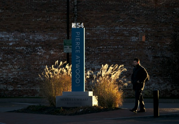 A businessman heads for the office after parking on the waterfront, Wednesday, Nov. 20, 2013, in Portland, Maine.