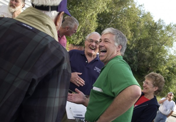U.S. Rep. Mike Michaud jokes around with supporters after speaking at a Labor Day celebration in 2004.