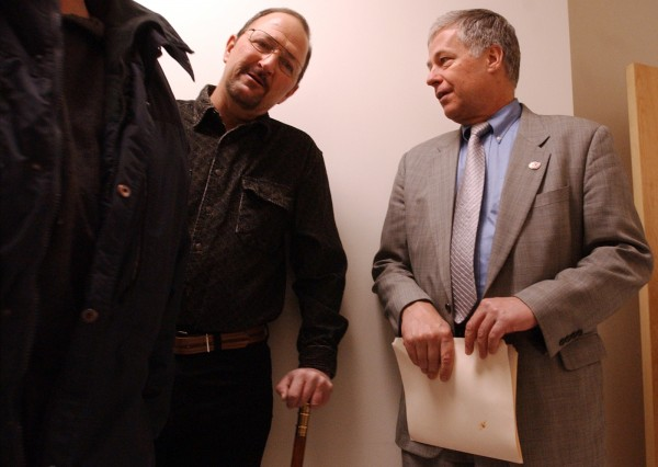 Rep. Mike Michaud talks with Brewer Mayor Michael Celli as laid-off Eastern Fine Paper employees file into a conference room at the Brewer Auditorium in 2004.