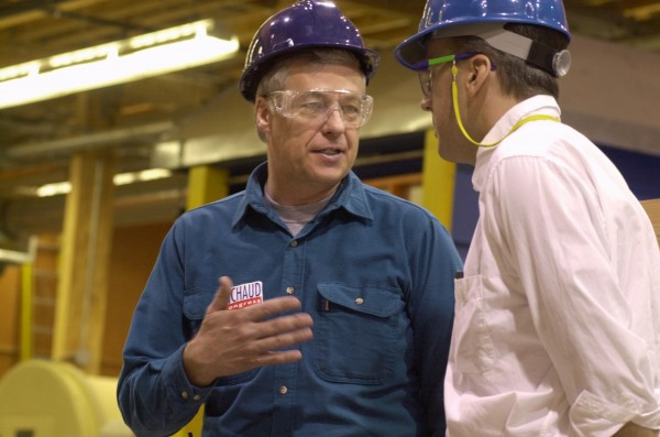 Democrat Mike Michaud (left) talks with research engineer Bob Lindyberg at the University of Maine's Wood Composite Center in Orono in 2003.