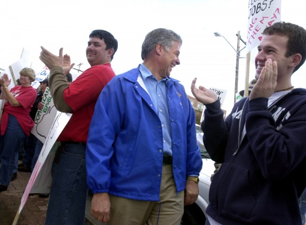Democrat Mike Michaud (center) chats with supporters at a rally in Bangor in 2002. J.R. Gibson from Machiasport (left) and Chris Harris of Old Town (right) attend the rally for Maine jobs.