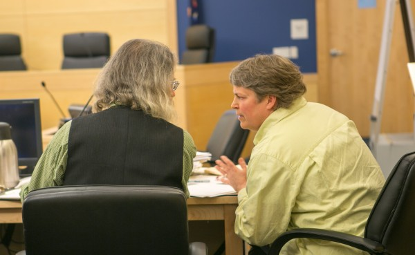 Peter Beckford (left) and his wife talk during their appellate hearing against Pisgah Mountain LLC at the Penobscot Judicial Center in Bangor on Tuesday, Feb. 12, 2013