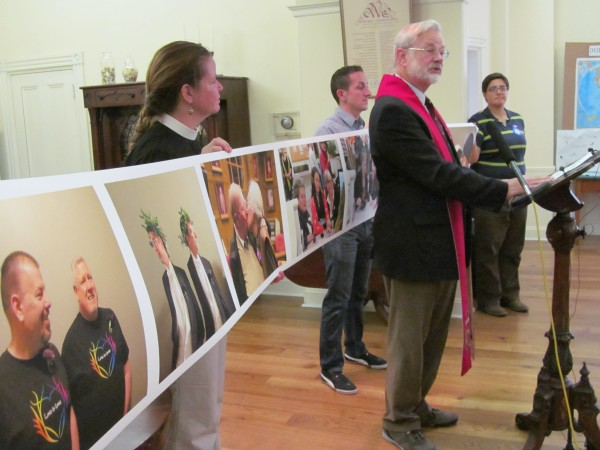 Rev. Don Rudalevige joins members of the organization EqualityMaine on Wednesday at the First Parish Church in Portland to commemorate the one-year anniversary of the vote to legalize same-sex marriage in Maine.