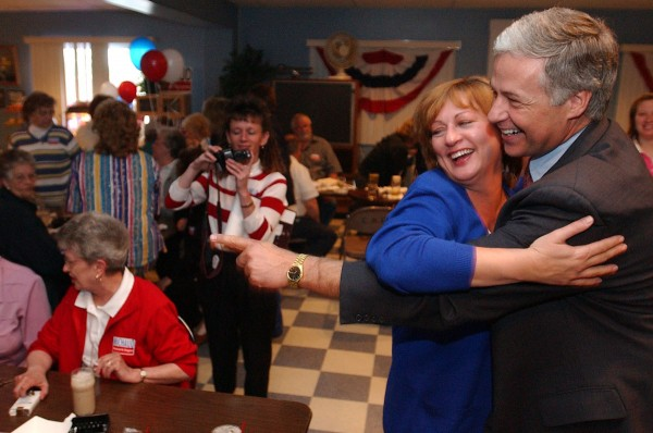 State Sen. Mike Michaud of East Millinocket, the Democratic nominee in the 2nd Congressional District, hugs Diane Gagnon of East Millinocket as he makes the rounds at Hamlet's Pub in 2002 to announce his victory in the primary election.