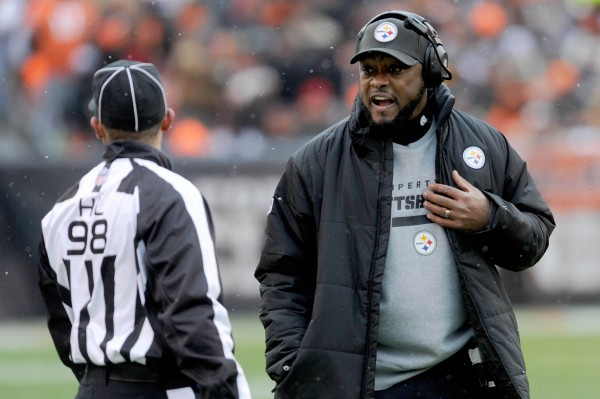 Pittsburgh Steelers head coach Mike Tomlin (right) received the support of New England Patriots coach Bill Belichick on Friday after Thursday night's situation in which Tomlin nearly interfered with an opposing kick returner.