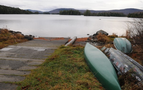 Canoes and boats sit next to the public boat launch at Prong Pond in Beaver Cove on Thursday, Nov. 7, 2013.
