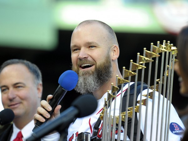 Boston Red Sox catcher David Ross speaks to the fans inside of Fenway Park prior to the World Series parade and celebration on Nov. 2.