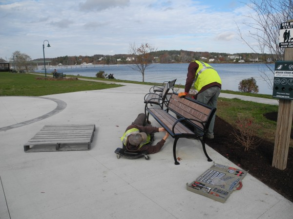 Shawn Chapman of Hermon, left, and Colt Van Aken of Hampden work this week to put some finishing touches on the new Harbor Walk. Belfast will hold a grand opening for the walkway, which was many years in the planning, beginning at 10 a.m. Saturday, Nov. 9 at the Belfast Boat House.
