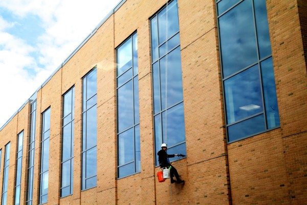A window washer spiffs up the glass at the new MaineGeneral Medical Center in Augusta on Wednesday. The hospital opens on Saturday, Nov. 9.