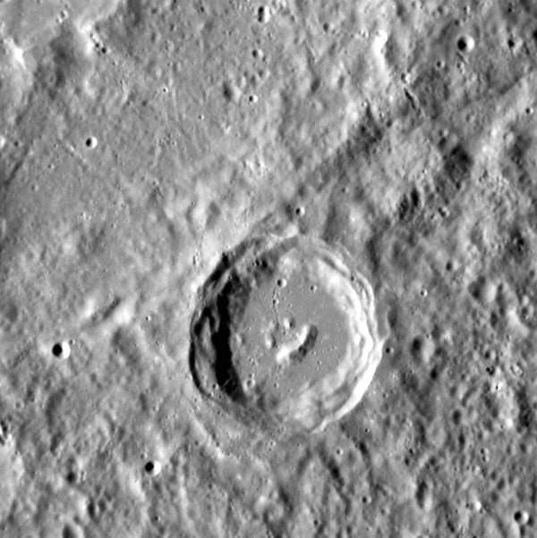 3TP EUOThe central peaks of a complex crater on the surface of Mercury, forming a happy face  in this undated NASA handout photo from its spacecraft MESSENGER, which is in the midst of a year-long orbit of Mercury.