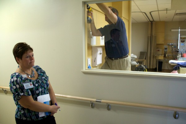 Nicole McSweeney, director of marketing and communications for MaineGeneral Medical Center, listens as CEO Chuck Hays (seen reflected in the glass) gives a tour of the new facility, due to open Saturday, Nov. 9.