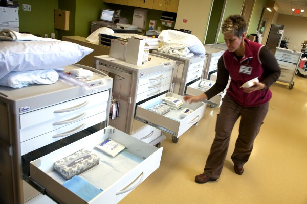 Registered nurse Denise Pouliot fills supply carts at the new MaineGeneral Medical Center in Augusta on Wednesday.
