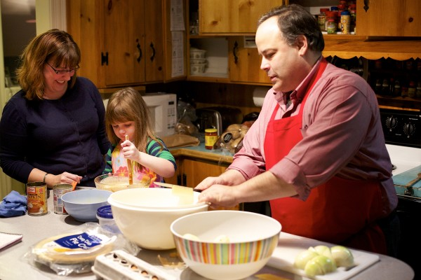From left, Paula Matlins and Hannah, 4, make pumpkin pie for Thanksgiving while Drew Matlins, right, makes potato latkes for Hanukkah Wednesday evening at their home in Bangor. The Matlins talk about how they're handling the confluence of Hanukkah and Thanksgiving this year as start of Hanukkah is the day before Thanksgiving.