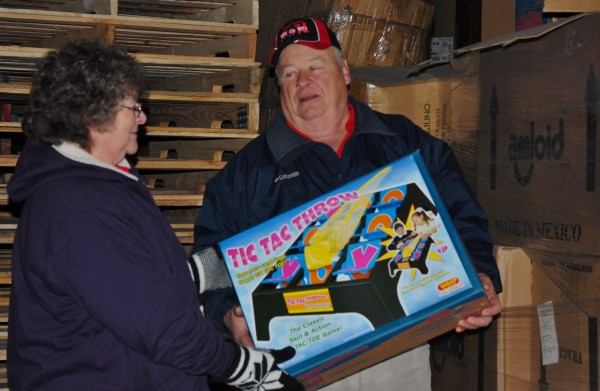 Rudy and Leigh St. Peter check out the thousands of toys stored in a St. Agatha warehouse as part of the annual Marine Corps Reserve Toys for Tots program. The couple anticipates giving toys to more than 2,300 needy Aroostook County children this year.