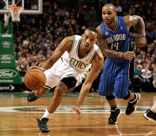 Boston Celtics point guard Avery Bradley (0) drives past Orlando Magic point guard Jameer Nelson (14) during the second quarter of Boston's 120-105 win at TD Garden in Boston Monday night.