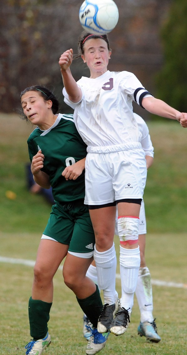 Orono's Hanna Renedo heads the ball in front of Fort Kent's Danielle Pelletier during Eastern Maine Class C final action on Wednesday at Orono.