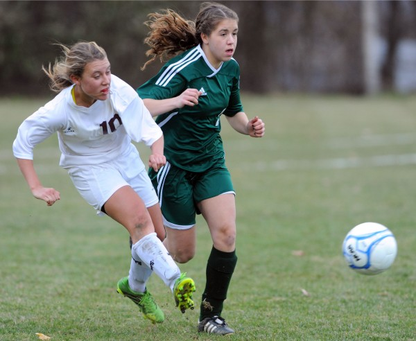 Orono's Diana Tyutyunnyk (left) pushes the ball ahead of Fort Kent's Jordan Tanguay during Eastern Maine Class C championship action on Wednesday at Orono
