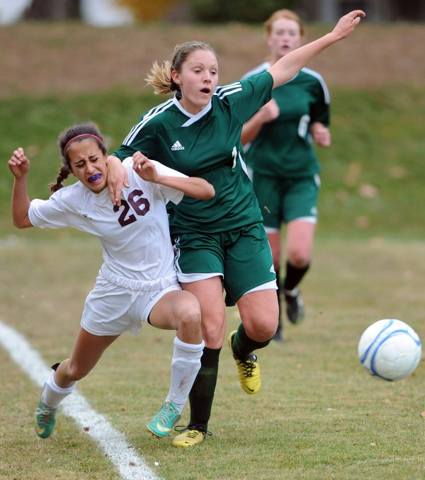 Orono's Becky Lopez-Anido is pushed by Fort Kent's Demi Pelletier during Eastern Maine Class C chamionship action on Wednesday at Orono.